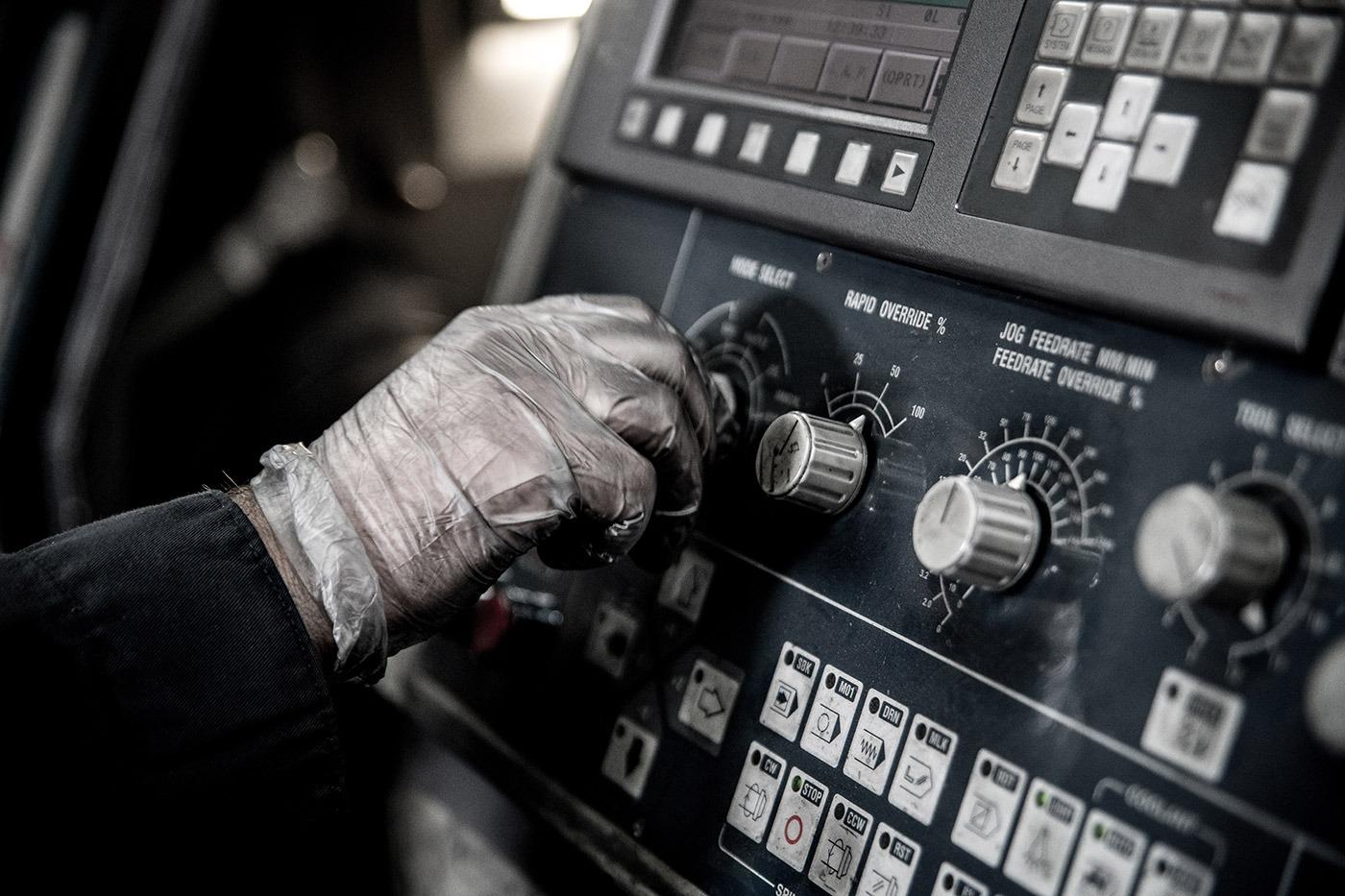 person programming industrial machine